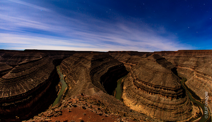 A full moon shines on the Goosenecks, a series of incised meanders on the San Juan River in SE Utah.