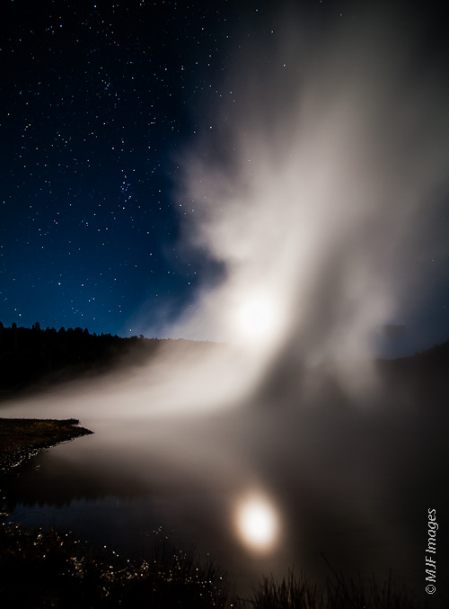 The moon creates a surreal scene in Lower Geyser Basin in Yellowstone National Park.