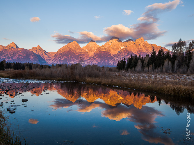 A beaver-dammed channel of the Snake River in Grand Tetons National Park is the perfect mirror for sunrise.
