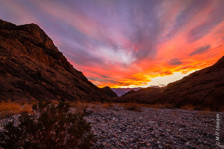 A colorful sunset floods into Redwall Canyon in Death Valley National Park, California.