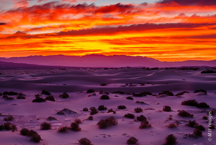 A colorful dawn breaks over Death Valley National Park in California.
