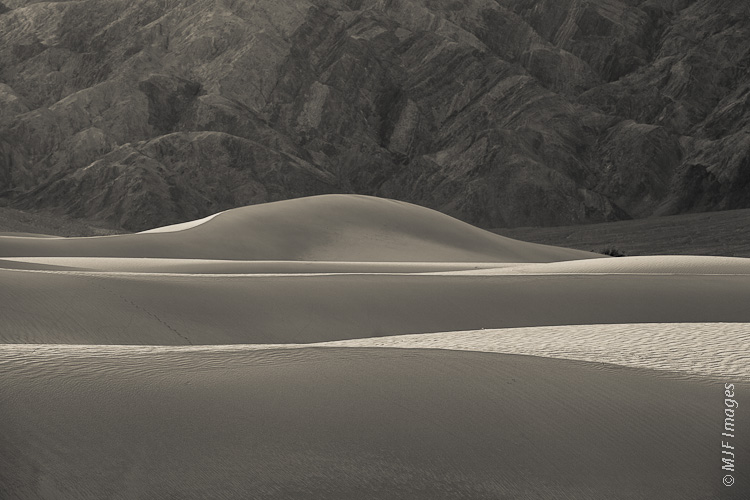 The sand dunes at Mesquite Flats in Death Valley, California, appear wave-like in the right light.