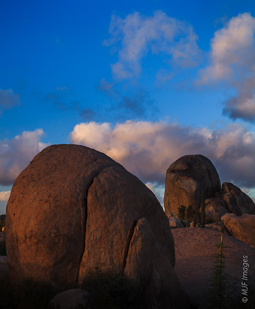 The enormous granite boulders of the northern Baja Peninsula desert catch the day's last light.