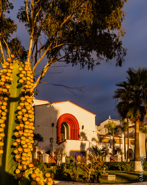 The Riviera, an architectural landmark in Ensenada, Mexico, basks in golden late afternoon light.