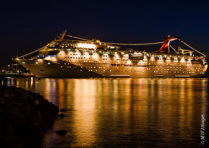 A Carnival cruise ship lies in Ensenada, Mexico's harbor.