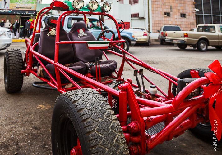 On the streets of Ensenada, Mexico, a dune buggy is freshly painted for Christmas.