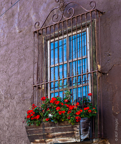 A plain wall and window are given a bit of color in Ensenada, Mexico.