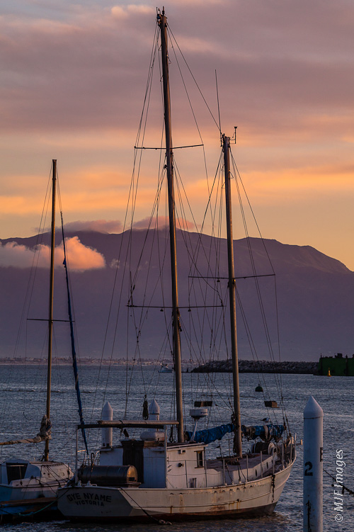 A sailboat lies safely in Ensenada, Mexico's harbor.