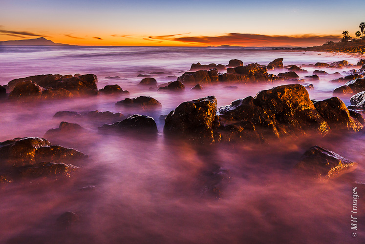 The rocky coastline of the northern Baja Peninsula in Mexico is a peaceful place to be at dusk.
