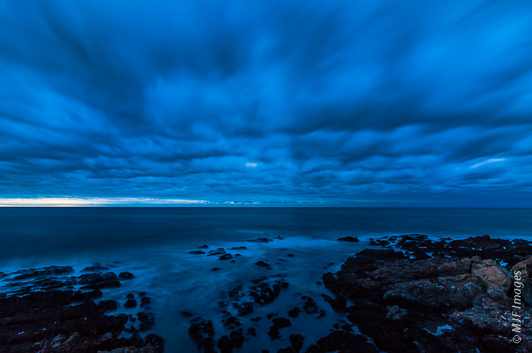 Winter on the California Coast and a storm approaches at dusk near Cambria.