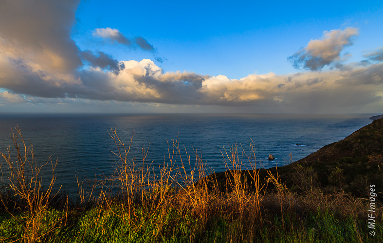 An early winter's morning on the California Coast near Big Sur brings clearing after an overnight storm.