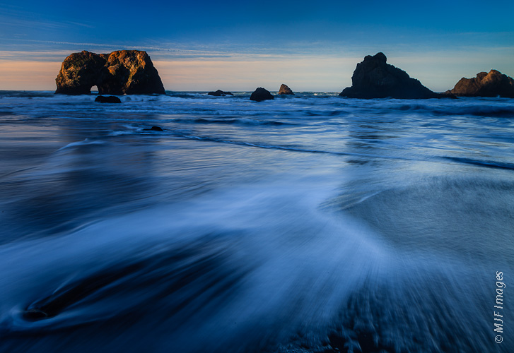 California's Mendocino Coast features sea stacks, arches and broad sandy beaches.
