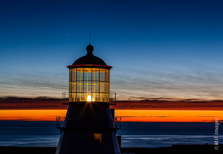 The Pacific Ocean and the day's last light stretch west from the Cape Mendocino Lighthouse in Shelter Cove, California.