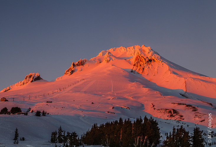 Mount Hood catches alpenglow from a setting winter sun.