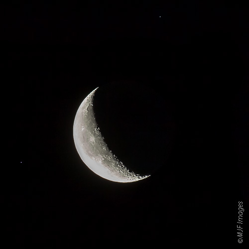 The crescent moon rises in the early morning of Friday the 13th, 2012.