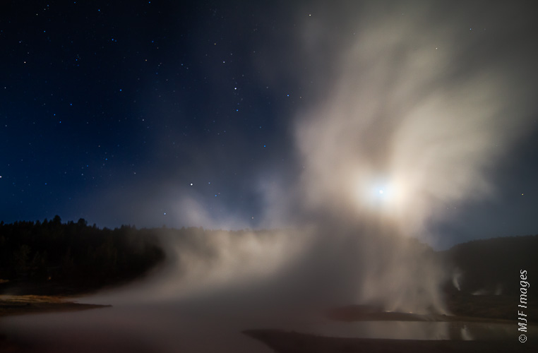 Moonlight and steam on a cold night at Hot Lake in Yellowstone's Lower Geyser Basin creates a mystical scene.