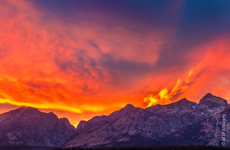 The Tetons appear to be catching fire beneath a gorgeous sunset.