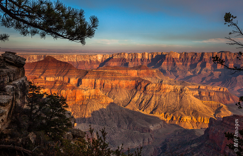 A smoky view of the western part of Grand Canyon from the North Rim.