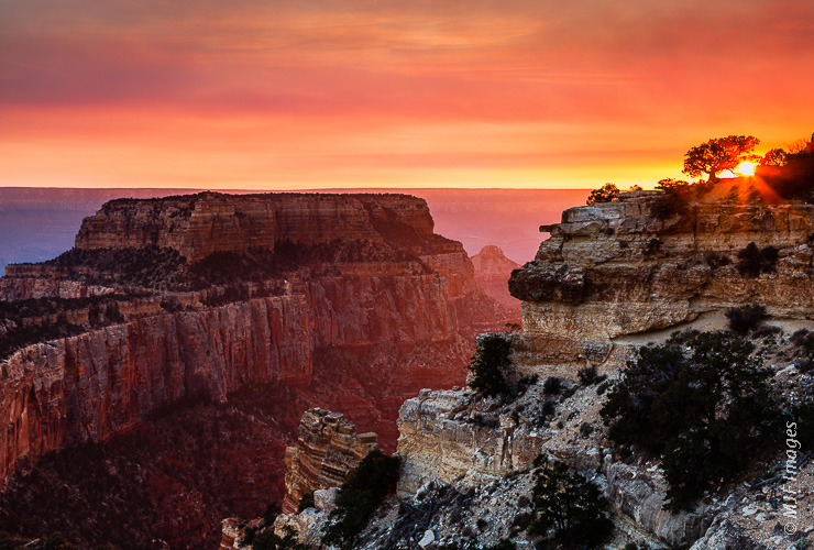 Cape Royal on the Grand Canyon's north rim sees a colorful sunset under smoky skies.
