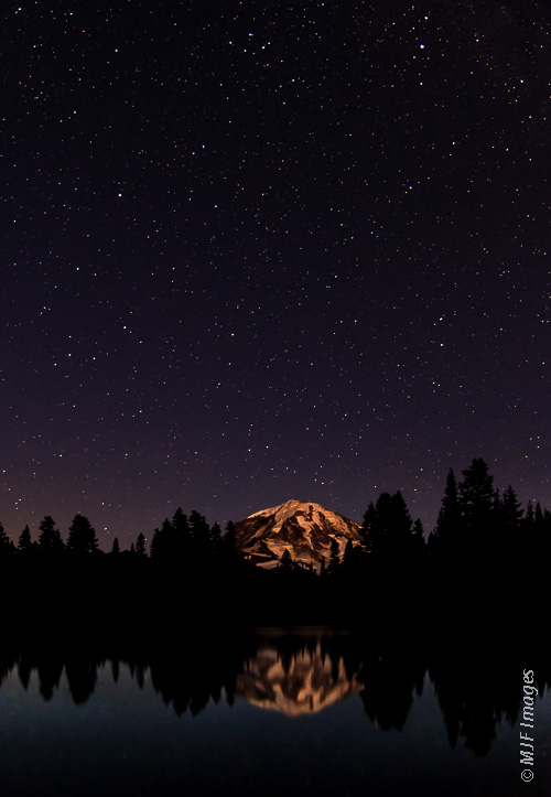 Mount Rainier and the night sky above Eunice Lake.