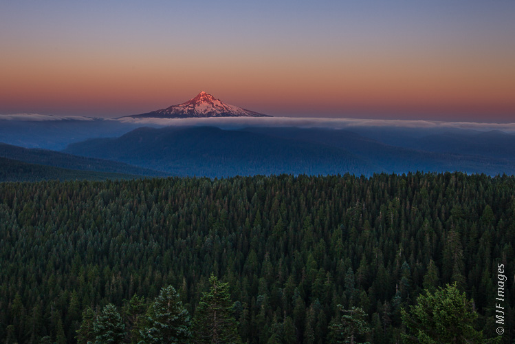 Luck is something I embrace.  While setting up in a rush for a sunset shot, I looked behind me and saw this view of Mount Hood, Oregon.  I quickly shot it without a tripod, as the unique light quickly changed.