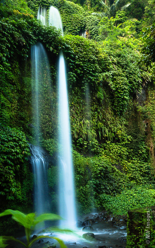 A waterfall in the jungle on the slopes of Mt Rinjani on the island of Lombok, Indonesia.