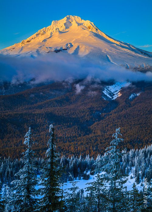 Beautiful Mount Hood is illuminated by alpenglow.  Mirror Lake is at bottom.