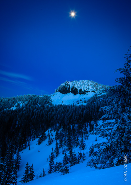 A crystal-clear and cold evening under the moonlight skiing near Mount Hood, Oregon.