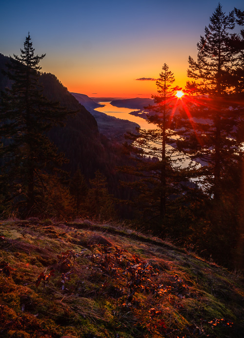 The sun sets over the mighty Columbia River as seen from Munra Point in Oregon.