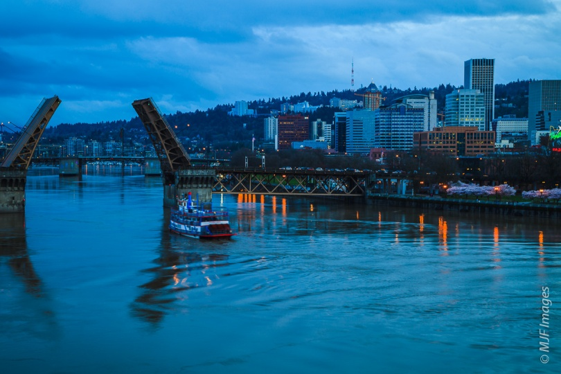 The Morrison Bridge in Portland, Oregon opens for a pleasure boat.