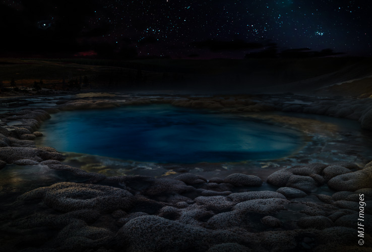 Sulfur Springs, a remote thermal area in Yellowstone National Park, reflects the pale light of evening.