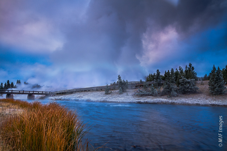 An icy early autumn morning along Yellowstone's Firehole River and the enormous steam plumes rising from Grand Prismatic Spring.