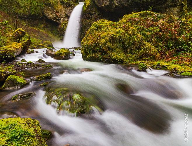 A little-known waterfall in Oregon's Columbia River Gorge requires much effort to reach, being set in a pristine and beautiful alcove not accessible by trail.