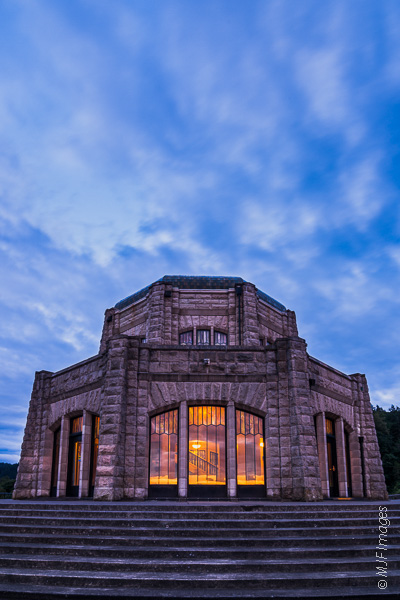 The landmark Vista House at Crown Point, Oregon, settles under a dusk sky.