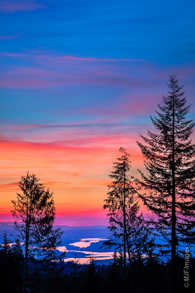 A vibrant dusk descends on the Columbia River, viewed from Larch Mountain, Oregon.