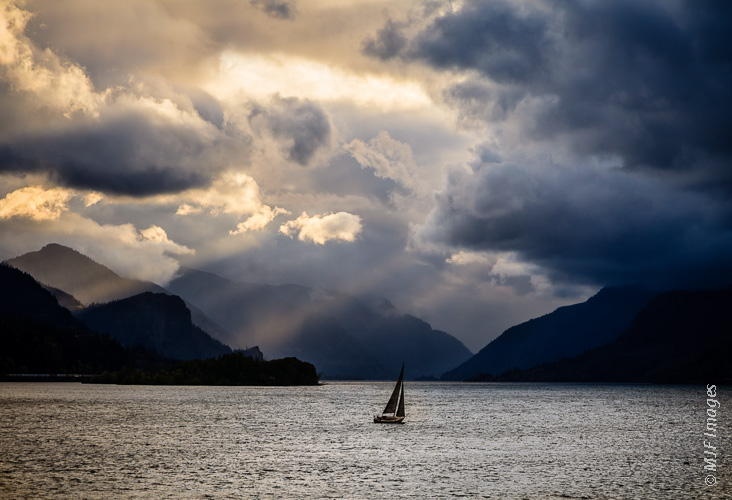 A lone sail boat takes advantage of a windy late-afternoon on the Columbia River in Oregon.