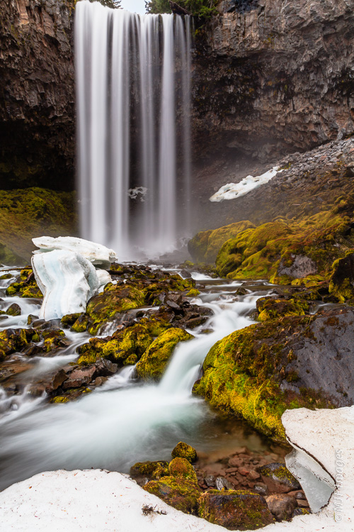 Tamanawas Falls is a pretty waterfall near Mount Hood, Oregon.  In April the falls hastens the snow's retreat.