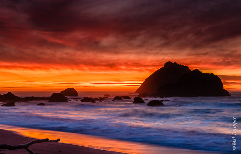 The sun goes down with a show of glory along the Redwood Coast, northern California.