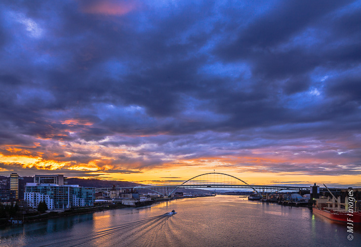 Sunset is a peaceful time to boat on the Columbia River in Portland, Oregon.