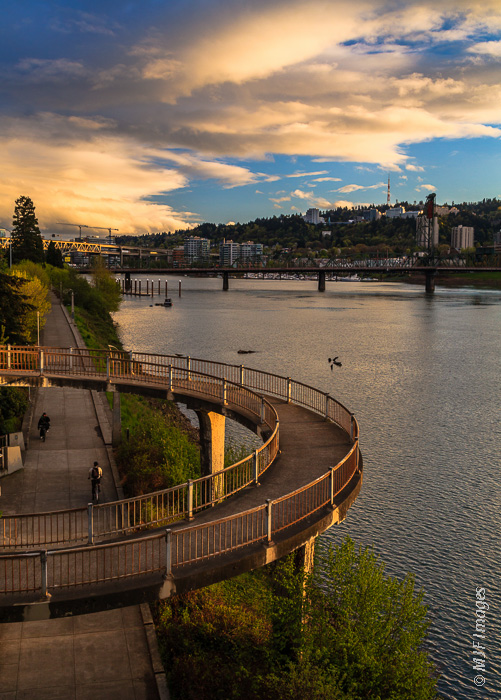 A spiral bike ramp allows bicyclists traveling on the Eastbank Esplanade in Portland, Oregon to access one of the many bridges over the Willamette River.