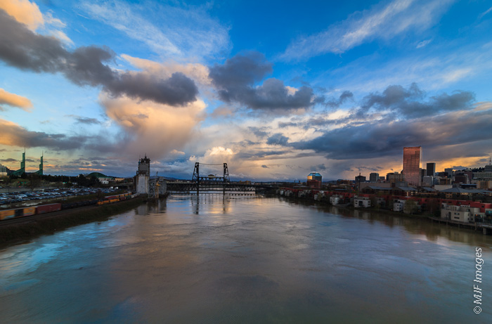 The Willamette River flows through Portland, Oregon, as viewed from atop the Broadway Bridge.