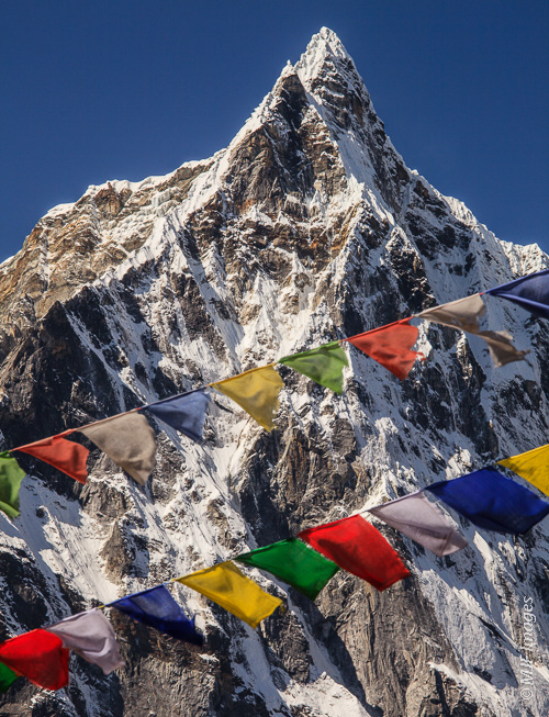 Documenting a climber's desires, and the spectacular peak of Taboche with prayer flags on the way to Everest Base Camp, Nepal.