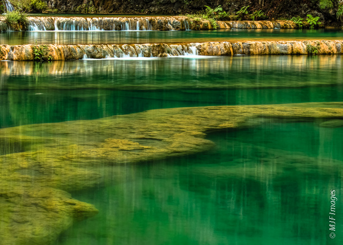 The clear pools at Semuc Champey in the Guatemalan highlands invite a cooling swim.