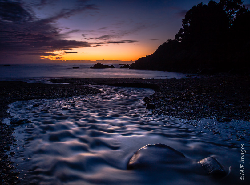 A small cove on the northern California coast features a stream, abalone shells, and a peaceful sunset.  I was pretty sure on exposure here, but bracketing for shutter speed gave me different looks to the flowing stream in the foreground.