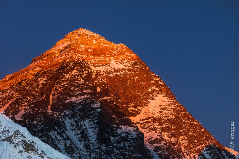 Alpenglow on Mount Everest from the 5400-meter high viewpoint of Kala Pathar in Nepal.