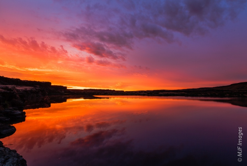 One of the many lakes in the Channeled Scablands of eastern Washington is calm and colorful at sunrise.