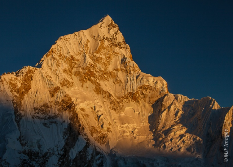 Alpenglow highlights the spectacular western face of Nup Tse near Mt Everest in Nepal.