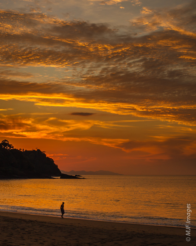 A lone man walks the beach on the remote Andamon Sea island of Tarutao off southern Thailand's coast.