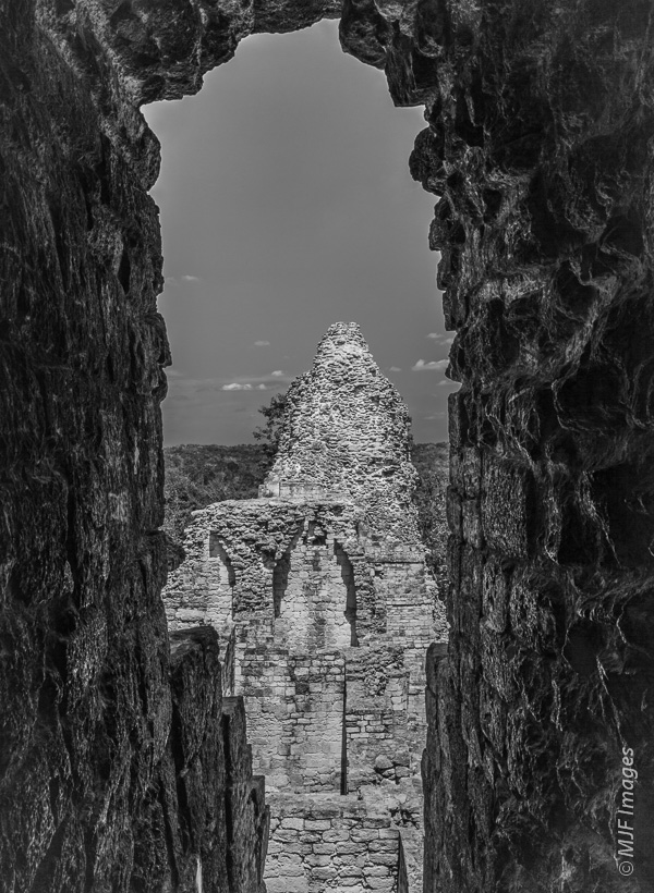 Inside the Mayan ruins of Xpuhil in the southern Yucatan, Mexico.  With contrast like this, bracketing for a broad range of exposure will give you more chances to get a usable image.  You could also try HDR with a bracketed set.