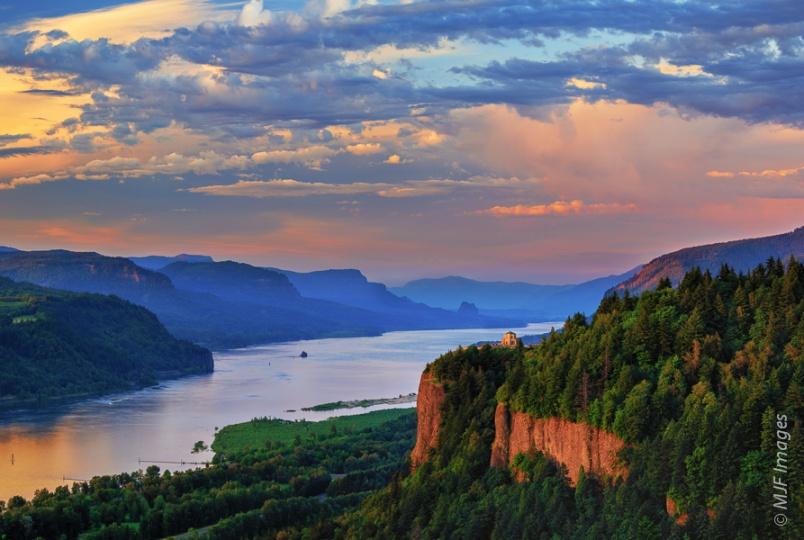 A fading day illuminates colorful skies and the basalt cliffs at Crown Point in Oregon's Columbia River Gorge.
